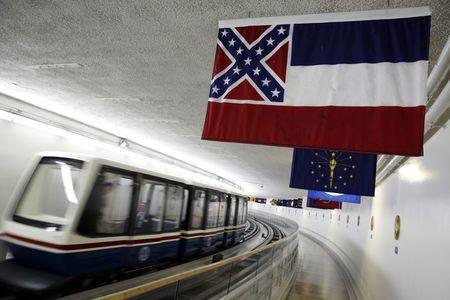 The Mississippi state flag, which incorporates the Confederate battle flag, hangs with other state flags in the subway system under the U.S. Capitol in Washington in this June 23, 2015, file photo. REUTERS/Jonathan Ernst/Files